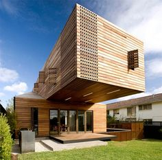 Trojan House Architecture by Jackson Clements Burrows in Melbourne Australia    This quite heavy house provides a creative solution to have more space while at the same time creating shade for the veranda underneath. The mix of the organic and geometric pattern create a contemporary piece and statement with wood.
