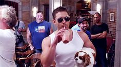 Jensen, laughing Clif and crew, and Gen's dog - SPN season 9 Gag Reel - I know he's being silly, but I just see the volleyball scene in Top Gun. ;) <--- this :D