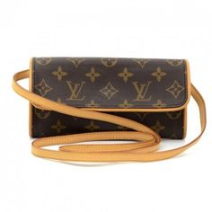 16ca1e65d16fa Authentic Louis Vuitton Twin Pochette PM in monogram canvas. It can be  carried as a clutch or a shoulder bag with removable natural cowhide  leather strap.