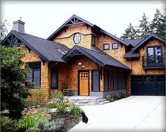 House style, contemporary Craftsman. Not usually a fan of shakes (wood shingle siding) because of the maintenance, but it looks great on this house, particularly with the complementing dark accent colors.