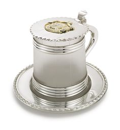 The Princes Bariatinsky: A Russian silver-mounted glass tankard and tray, Robert Kokhun (Colqhoun), Nichols & Plinke, St. Petersburg, 1867, the tapering glass body matted to resemble a barrel, the silver-mounted bands attaching to the scrolled handle, the hinged lid cast with pie-crust edge and applied with the chased and gilded coat-of-arms of the Princes Bariatinsky, complete with silver liner or tray with conforming pie crust edge.