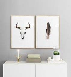Print with a poster of a buffalo horn on a side board.
