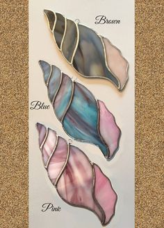 Bring a bit of the ocean to your home by hanging one of these gorgeous seashell suncatchers in your window. Currently available in three colors: ~ Brown