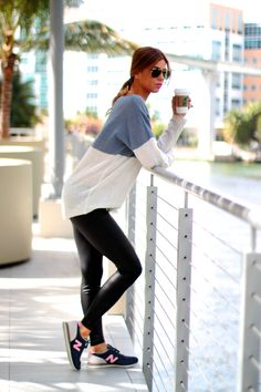 sporty meet chic look, blue and pink new balance 620, pink lips, black raybans, black leggings, sweater, dainty necklaces, layer necklace, starbucks, coffee run