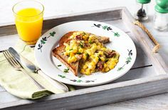 Creamed sweetcorn on wholemeal toast with chives and sundried tomatoes