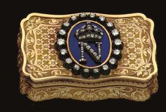 A FRENCH GOLD, ENAMEL AND DIAMOND SNUFF-BOX CIRCA 1860 Shaped rectangular, the base and cover engraved and chased with flowering trellis panels with foliate borders, the cover applied with diamond monogram of Napoleon III over a translucent blue enamel ground, the sides with conforming foliate borders, marked on cover bezel 3½ in. (8.9 cm.) long