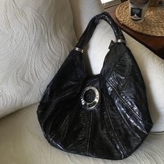 """NICOLE LEE BAG GORGEOUS BLACK NICOLE LEE BAG.  AWESOME DETAILS Include Beautiful Buckle Jeweled FLap Closure. Top Zipper Closure.  l  Zipper Side Pocket inside. 2 small pockets inside without zippers. Satin Lined Animal Print inside. 2 Silver Rings on each side of Shoulder Straps.    Shoulder Straps measure 10"""" from Top of Shoulder to Top of Flap on Bag.  20"""" across.  17"""" from bottom of Strap to Bottom of purse. Inside is Very OPEN and ROOMY.  ABSOLUTELY GORGEOUS BAG!!! Nicole Lee Bags…"""