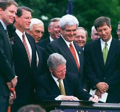 President Bill Clinton signs into law the two budget reconcilation measures in a White House ceremony on the South Lawn on August 5, 1997. BACKGROUND L to R:Thomas M. Davis III,R-Va.,Vice President Al Gore, Frank Lautenberg,D-N.J., Steny Hoyer,D-Md., Newt Gingrich,R-Ga., Bill Archer,R-Texas and John R. Kasich,R-Ohio. (Photo: Douglas Graham/Congressional Quarterly/Getty)