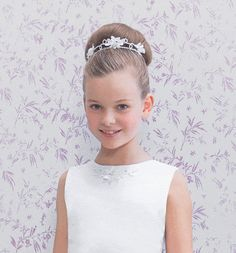 Sweep hair back into a high, smooth updo, framed by a classic double band floral bun vine Communion Hairstyles, Tiara Hairstyles, Dance Hairstyles, Flower Girl Hairstyles, Little Girl Hairstyles, Party Hairstyles, Trendy Hairstyles, Wedding Hairstyles, Flower Girl Updo