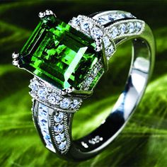 stunning 4 carat Scienza™ Lab-created Emerald Centerpiece layered in luxurious  					platinum.