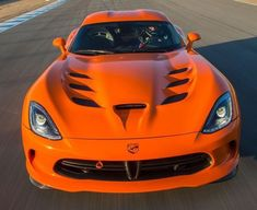 The Dodge Viper VX was unveiled at the 2012 New York Motor Show by the American car company Chrysler. Check Out This Amazing Dodge Viper Video Next Page: Viper Engine and Specifications Bugatti, Lamborghini, Ferrari, Ford Mustang, Modern Muscle Cars, Automobile, Dodge Viper, Viper 2017, Power Cars