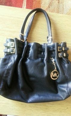 New listing Michael Kors purse black with gold detail