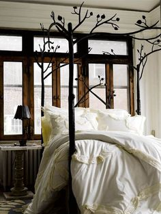 Wish I would have seen this great canopy bed before we bought ours. I love the branches and the romantic flare.
