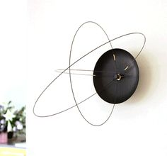 The Orbits Clock is a uniquely designed clock that contains 3 rotating circles all contained within each other, with the largest circle on the outside representing the hour hand, inside that circle is...