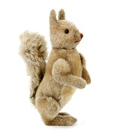 """Rare German grey squirrel, probably Strunz, grey mohair, black boot button eyes white felt disc behind, Jointed limbs, white mohair chest and long mohair wired tail, 1920s - 9.5""""   Notes: This squirrel is virtually identical to the Steiff, 1925-33, but does not have the tail joint. Most probably Strunz as they are well known for replicating Steiff products"""