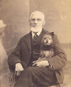 Man Holding His Dog. Both look quite shocked!