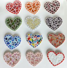 Mosaic heart magnets. How could we make these at school? cookie cutters? hmmm....