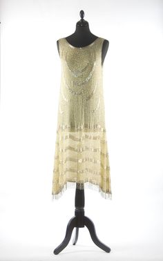 Vintage 1920s beaded flapper dress in pale yellow with silver beaded work s - m