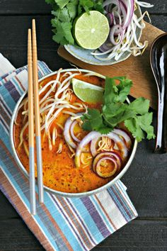 Northern Thai Curry Soup with Chicken. A coconut milk based soup loaded with rice noodles and topped with bean sprouts, cilantro, red onion and lime!