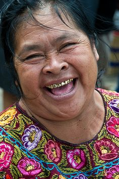 A mouth fill of gold teeth...no wonder she is smiling!
