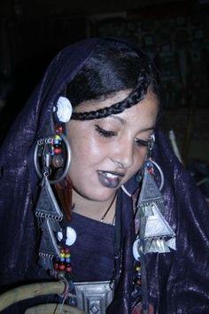 A Tuareg woman wearing traditional jewellery. Algeria