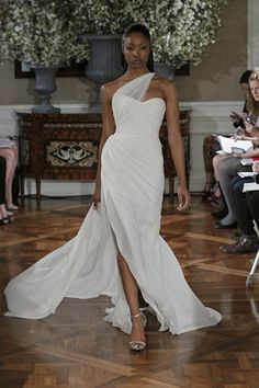 With a one shoulder organza strap, this Romona Keveza gown steps outside of ordinary