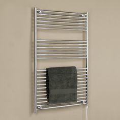 """30"""" Extra Tall Bergama Wall Mount Plug-In Electric Towel Warmer  The Bergama Extra Tall Liquid Filled Towel Warmer features ample room and power to warm a full set of bath and hand towels. This liquid filled towel warmer has a traditional design with its round side rails and will blend with any bath style. $391.97 ( Oil Rubbed Bronzed Powdercoat )    Description   •  Made of heavy-duty 20 gauge steel.    •  Luxury line of towel warmers with premium heating element.    •  Filled with glycol…"""
