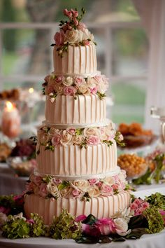 Pink wedding cake with roses...beautiful!