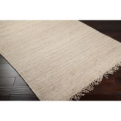 <li>Let the natural style of this jute rug enrich your home's decor</li> <li>Area rug is hand-woven from 100-percent jute</li> <li>Rug features a bleached tone which will match about any decor</li>