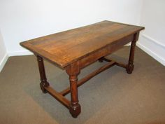 A 19th century English Oak jointed refectory table with plank top on balustrade legs with three piece stretcher of good colour and proportion