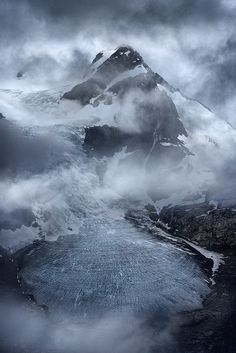 Unbroken by Exploring Light | Mountain peak enveloped with incredible atmospheric conditions on the shoulder of a storm in the Coast Mountains, BC.