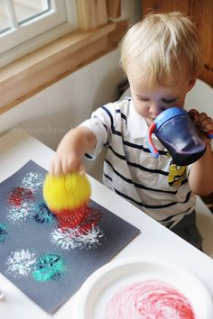 Fireworks craft using porcupine ball, paint, and glitter. (or glitter paint)