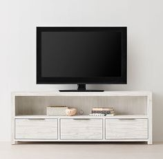 RH TEEN's Laguna Wide Media Console:Our collection's versatile, clean-lined profile features a weathered finish, flat-front drawers with a slim metal pull and simple block feet.
