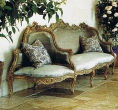 Louis XV canape a confidante in the home of Janet de Botton, Provence.