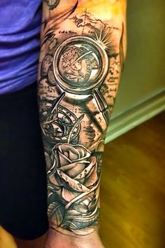 Cool tattoo on the forearm. It symbolizes travel.