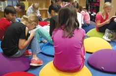 Cool seat pods -- would be great by the window seats in the library for kids to sit on!