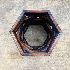 In our charred finish Hexagon Shelves, Blue Pink Roses, Picture Frames, Small Potted Plants, Staining Wood, Shelves, Geometric Shelves, Wall Anchors, Stud Walls