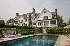 Colonial home with backyard pool and stone waterfall designed by Greenwich, CT interior designer Linda Ruderman
