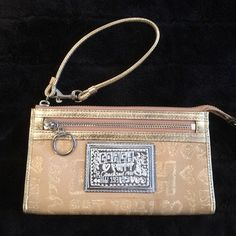 NWOT Rare Gold Poppy Wristlet NWOT. No trades. Coach Bags Clutches & Wristlets