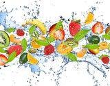 Fototapety Fresh fruits in water splash, isolated on white background