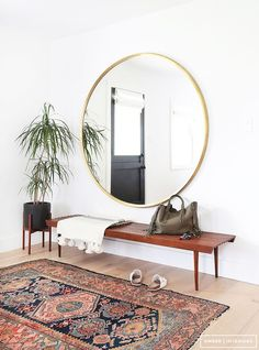 Simple round mirror with teak bench