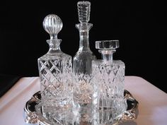 3 CRYSTAL DECANTERS and Silver Plate Tray