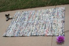 You could use the same weaving method as the baskets but create larger solid pieces that could be used to cover up shelving, etc.......Recycled newspaper rug.... 100.00