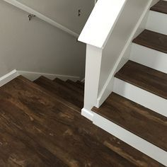 Luxury Vinyl Plank On Stairs With White Risers Luxury