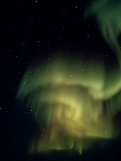 Ghostly Aurora Borealis  Photograph by Norbert Rosing  The aurora borealis illuminates the heavens with ghostly patterns.