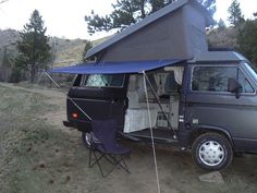 Fast easy van tarp awning; extendable tent poles slide into PVC elbows and short PVC pieces. flag pole brackets would work here too. Stake down ropes for added structure. Attach tarp over the roof of the van with bungee cords?