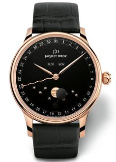 "This is a more ""simple"" Jaquet Droz watch with an annual calendar and a quirky moon phase indicator. Called the ""Eclipse,"" it comes in a 18k gold case and a nice black enamel dial. Nice? Sure. Super Jaquet Droz in read more..."