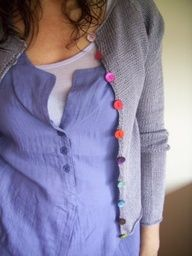 Change out boring buttons on a cardigan with some colorful ones