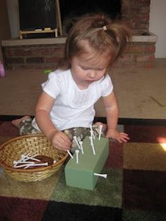 "He would love to hammer ""nails"" this way!! Grab a block of styrofoam at the dollar store (The green kind is floral foam. Put some tees in a bowl and have your little one carefully push each tee into the foam. Ready to clean up? Use that pincer grip to pull them out!"
