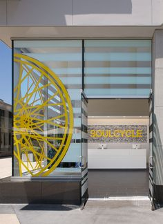 The Most Common Spinning Mistakes SoulCycle Instructors See Club Design, Gym Design, Retail Design, Fitness Design, Storefront Signage, Hotel Signage, Vinyl On Glass, Window Graphics, Indoor Cycling